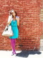 Loralei is wearing the envy dress by Lush and carrying the hazel handbag by Vieta for bellamaven.com