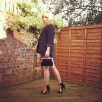 A classic black blazer teamed with a leather skirt